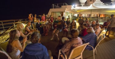 The night the ship traveled between the ports of Takoradi and Tema in Ghana, Unreasonable Mentor Kathy Rogers coordinated a drum circle on Deck 7.