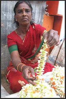 A flower seller sitting near a temple
