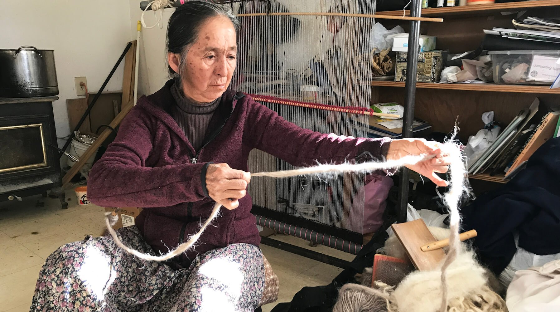 Navajo woman weaving sheep's wool